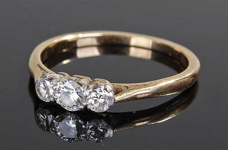 18 carat gold diamond ring, the ring set with three diamonds on a platinum