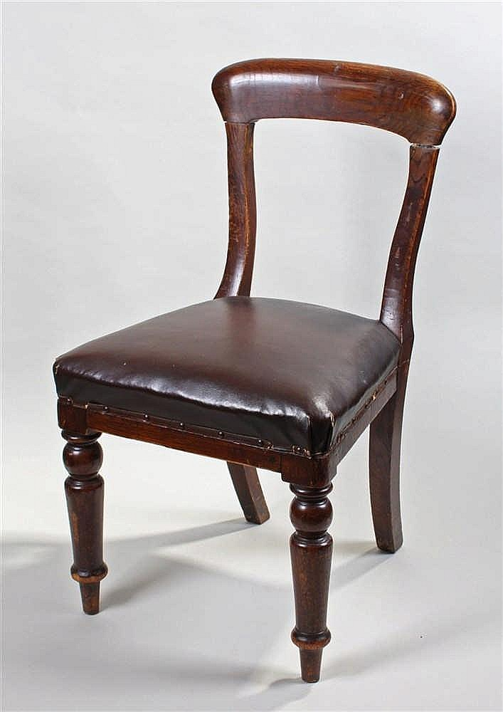British Rail oak chair, the arched back with stuff over seat and turned leg