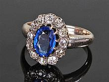 White metal diamond and sapphire, the central sapphire surrounded by twelve
