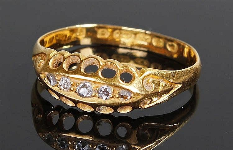 18 carat gold diamond set ring, the ring with a row of five diamonds to the