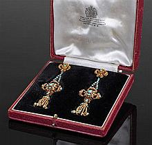 Pair of gold and turquoise set drop earrings, with a ribbon tied tip above