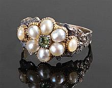 Late 18th/early 19th Century pearl ring, the pearls set around a peridot wi
