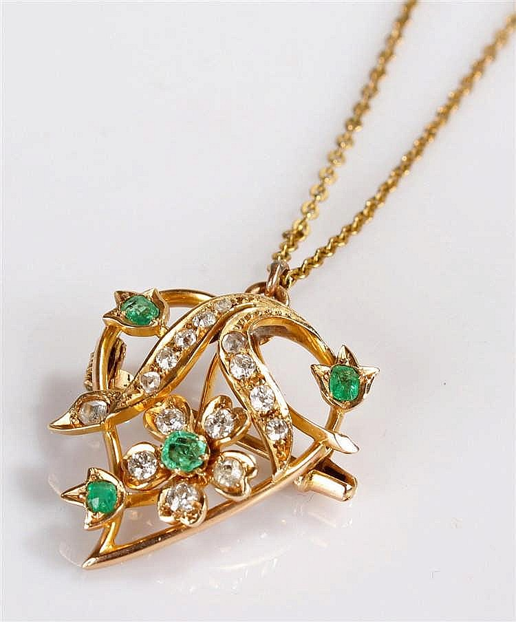 Yellow metal diamond and emerald pendant, the leaf shaped pendant with a fl