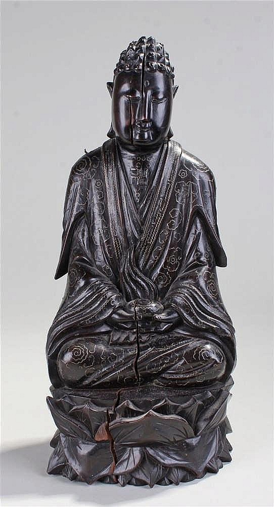 19th Century ebony and silver inlaid figure of Buddha. The silver inlaid to