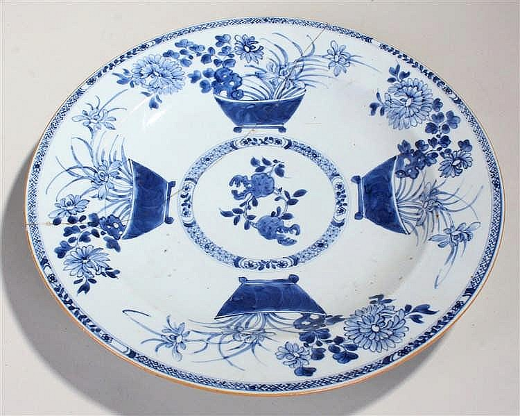 19th Century Chinese blue and white charger, decorated with flowers in urns