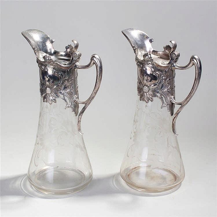 Pair of WMF silver plated and cut glass claret jugs, the silver plated top