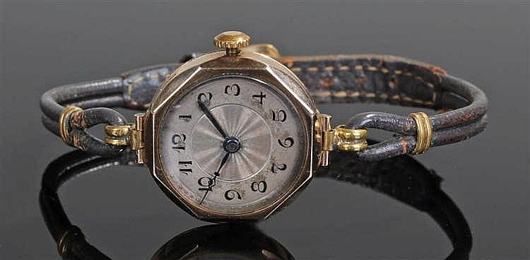 Ladies 9 carat gold wristwatch, the silvered dial with Arabic hours, angled