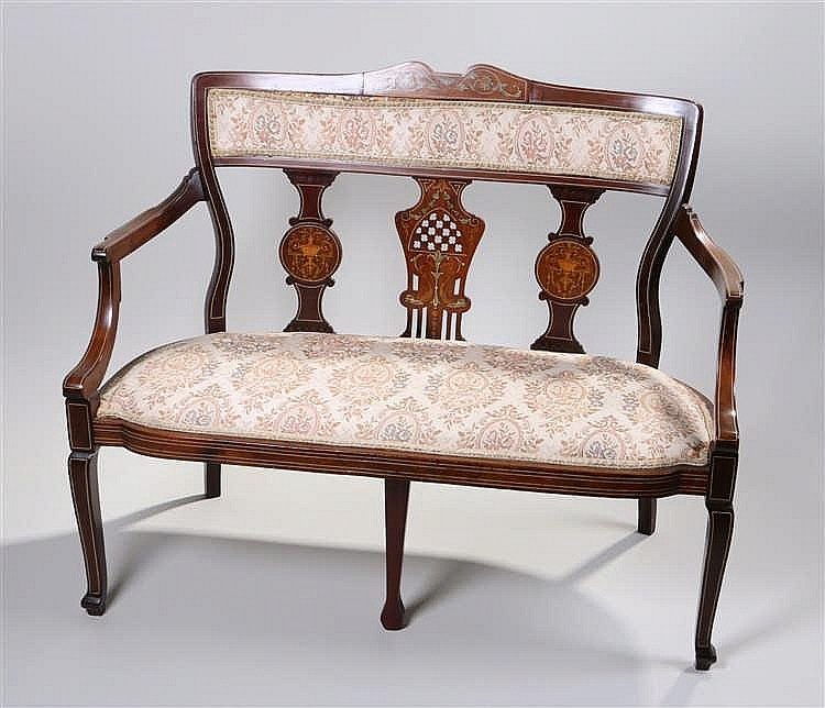 Edwardian mahogany and inlaid settee, the arched inlaid top rail with pad b