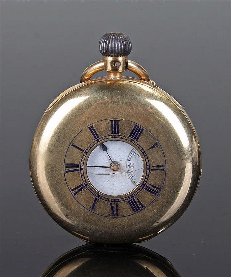 18 carat gold half hunter pocket watch, the central opening surrounded by e