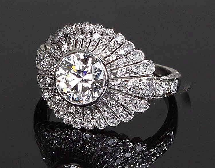 White metal diamond set ring, the central diamond at 1.18 carats with a dia