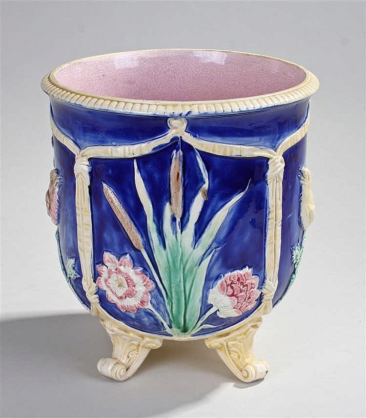 Majolica jardiniere, decorated with bull rushes, birds and flowers raised o