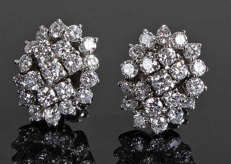 Pair of diamond earrings, the white metal earrings each set with twenty one