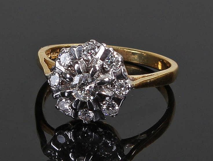 Diamond cluster ring, the central round, brilliant cut stone surrounded by