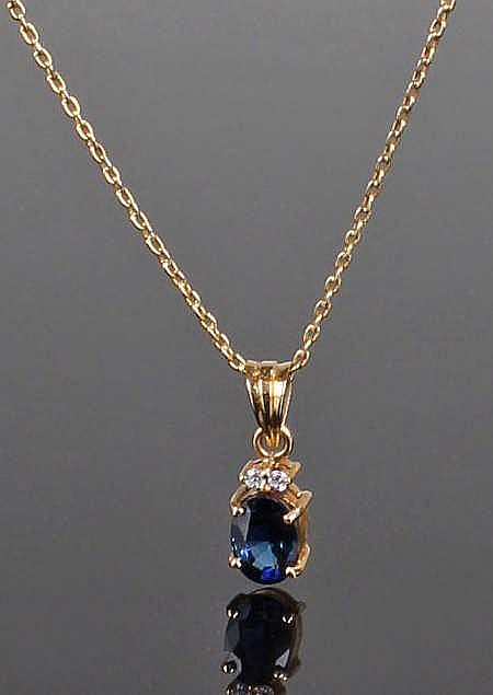 Sapphire and cubic zirconia necklace, the 9 carat gold chain with an 18 car