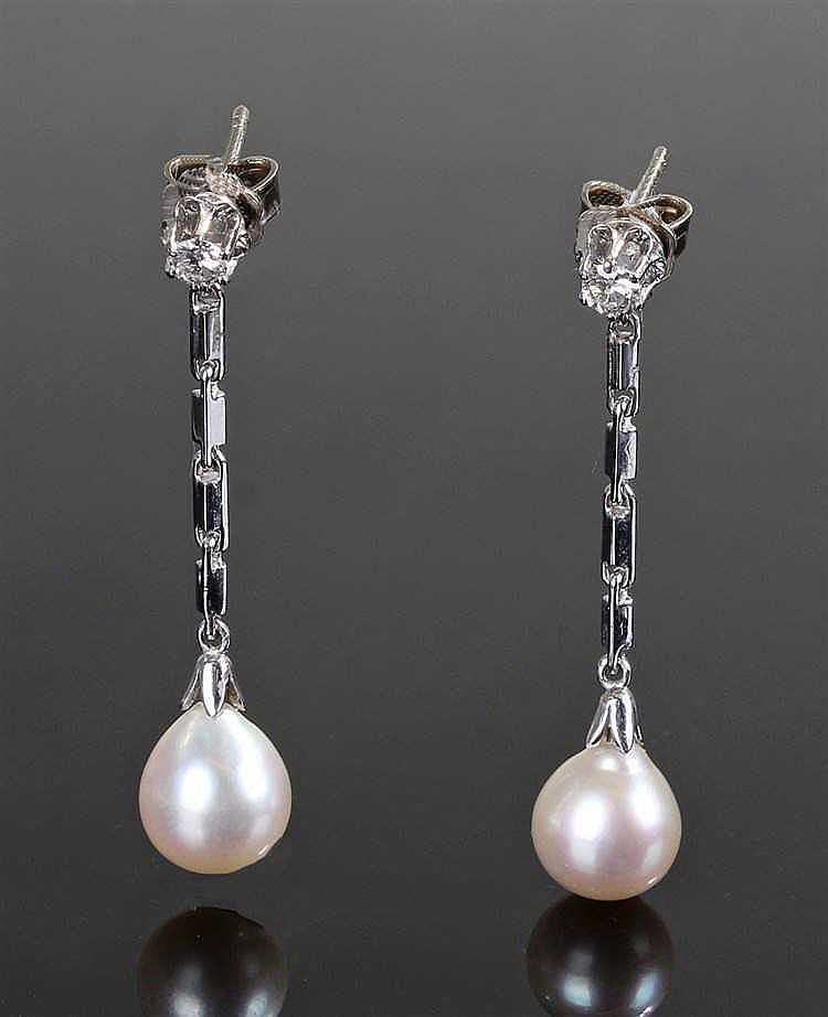 14 carat gold diamond and pearl earrings, the diamond set top above a drop