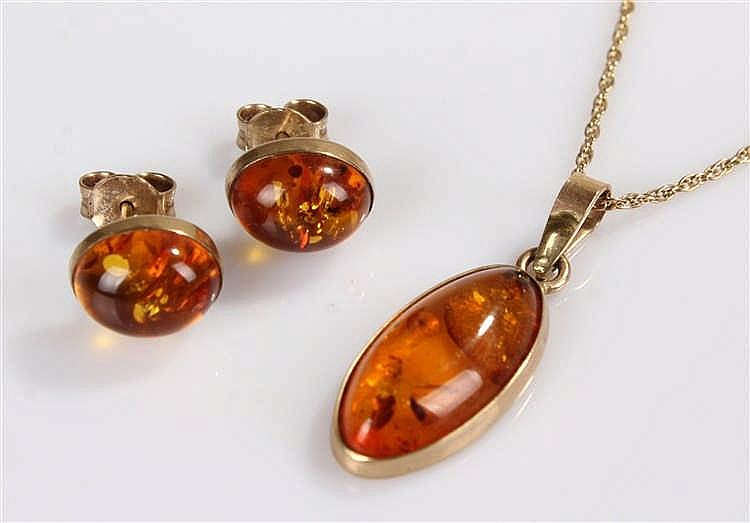 9 carat gold, amber set jewellery set with a pendant and a pair of earrings
