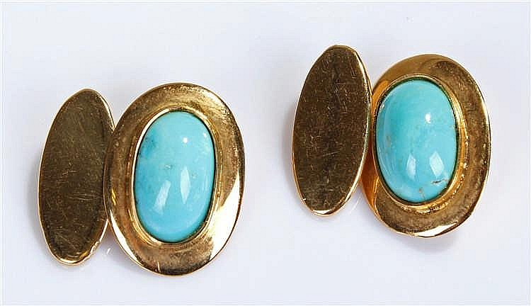 Pair of turquoise set cufflinks, the oval cabochon stones set in unmarked y