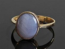 18 carat gold star sapphire brooch, the star sapphire set within an oval mo