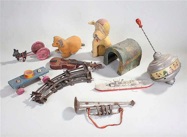 Mixed toys, to include two stuffed dog toys, a ship, two instruments, a spi