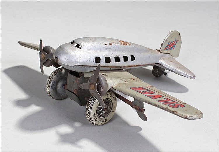 Tinplate clockwork toy, of the Silver Bullet aeroplane, the twin propeller
