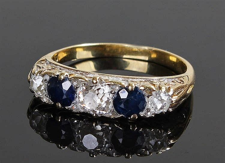 18 carat gold diamond and sapphire ring, with two sapphires and three diamo