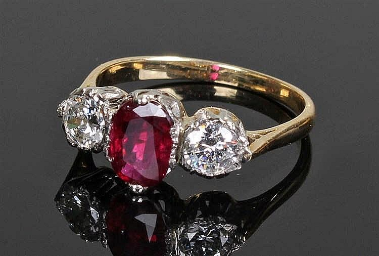 Ruby and diamond ring, the central ruby flanked by diamonds, the ruby at 1.