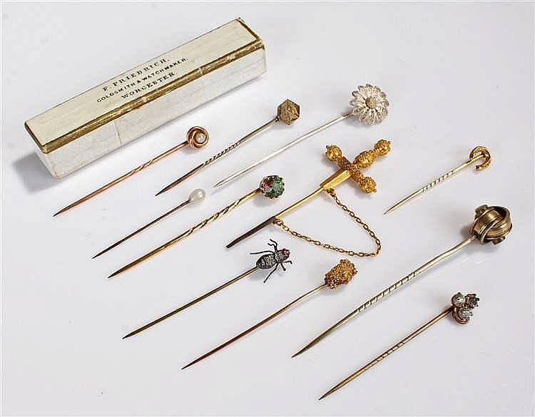 Collection of stick pins, to include a nuggert example, a fly, sword, ston