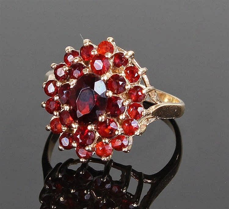 9 carat gold garnet cluster ring, the stepped garnet head in three rows, ri