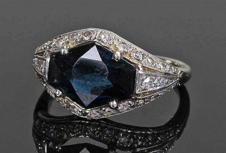 Sapphire and diamond ring, the central sapphire at 2.20 carats, diamonds to