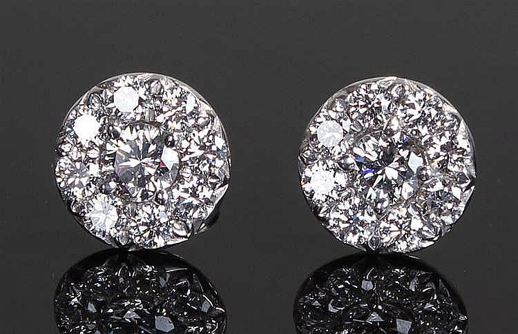 Pair of diamond set earrings, the round earrings with an estimated total of