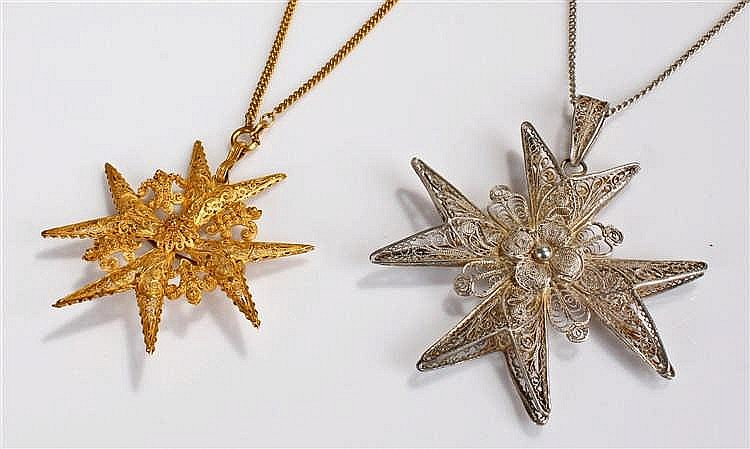 Two star pendants, the first in yellow metal with fret pierced geometric sw