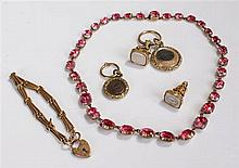 Two seals, together with a hair locket, a 9 carat gold padlock bracelet, an