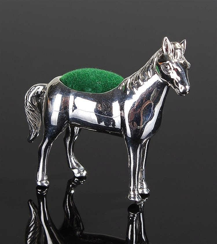 A silver pin cushion in the form of a horse