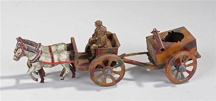 German tinplate toy, of a pair of soldiers in a horse drawn carriage and gu