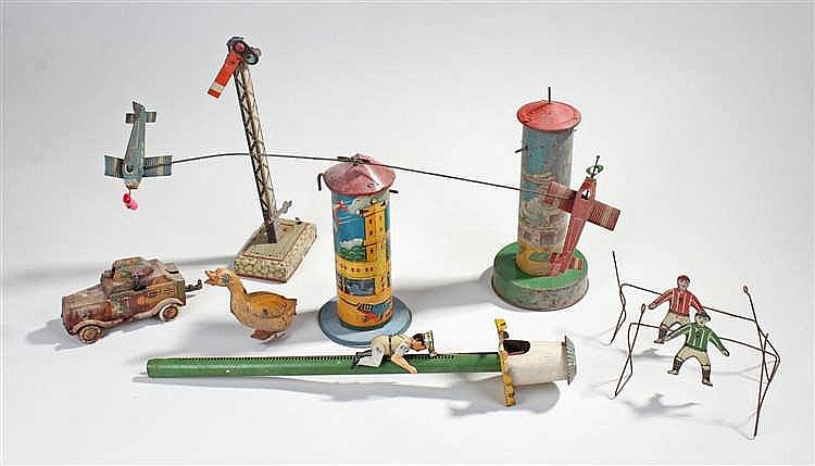 Mixed tin plate toys, to include an armoured truck, a goose, a climbing fig