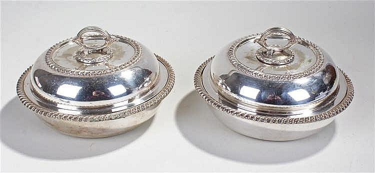 Two silver plated circular vegetable dishes, the branch handle above gadroo