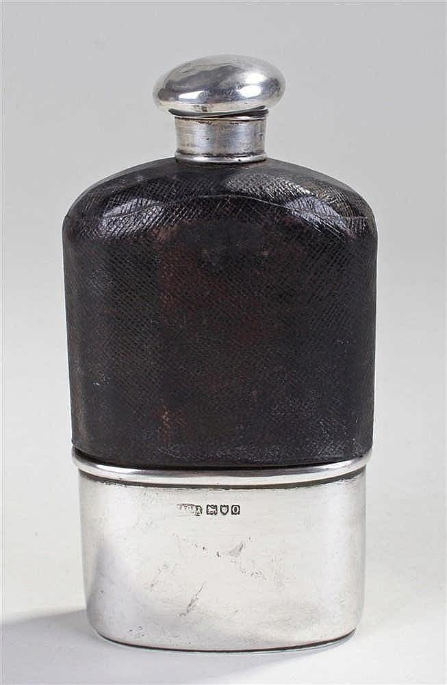 Asprey silver and leather hip flask, London 1909, the screw cap above a lea