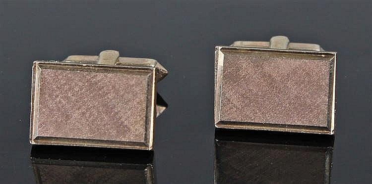 Pair of 9 carat gold cufflinks, the rectangular top with polished panel wit