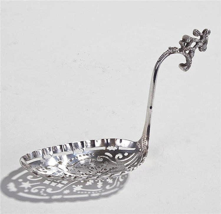 19th Century Dutch silver sifter spoon, a figure above an arched handle lea