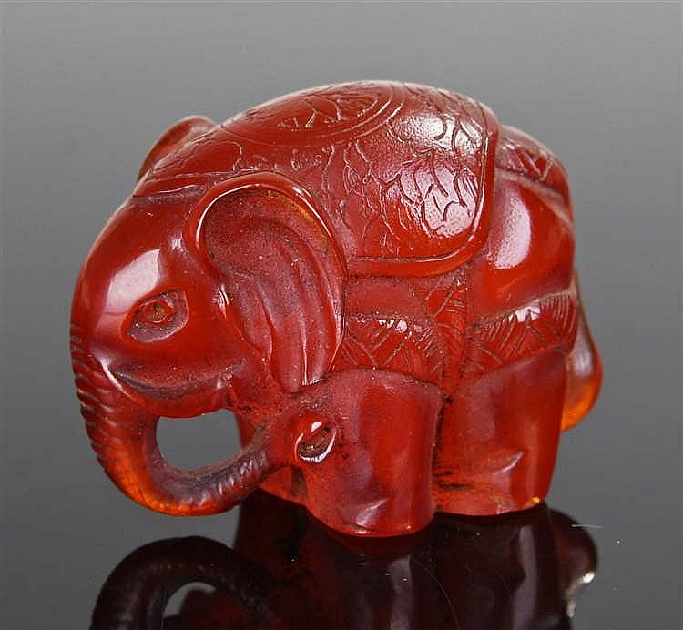 Japanese amber carved elephant, the elephant with an etched scroll decorati