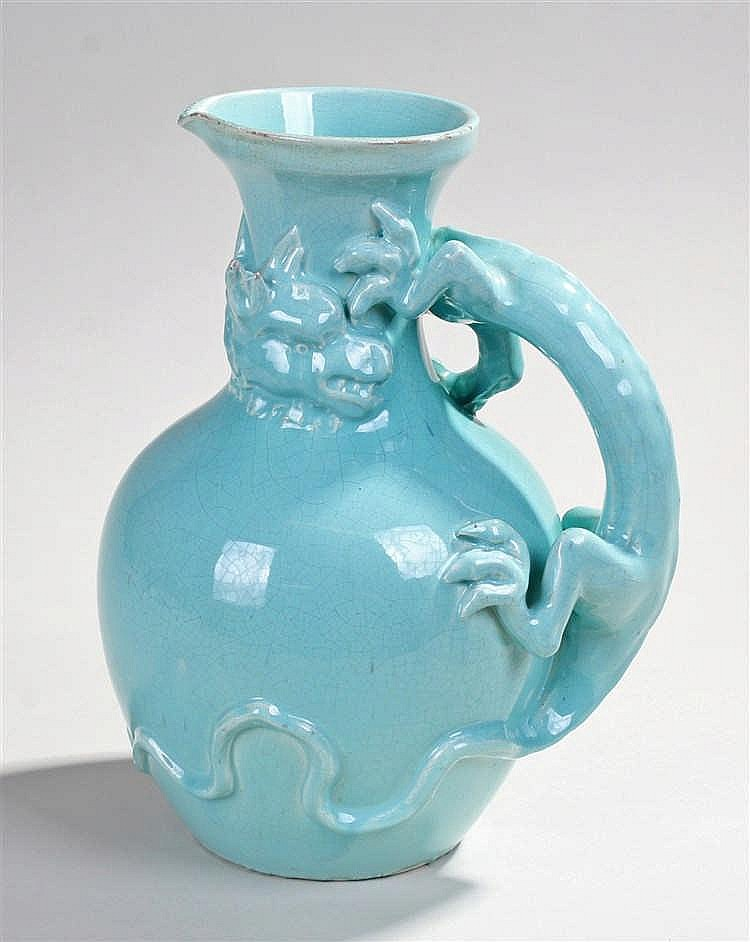 Chinese turquoise glazed jug, with a trailing dragon, 27cm high