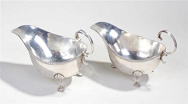 Edward VII pair of silver sauce boats, Birmingham 1908, maker Asprey, with