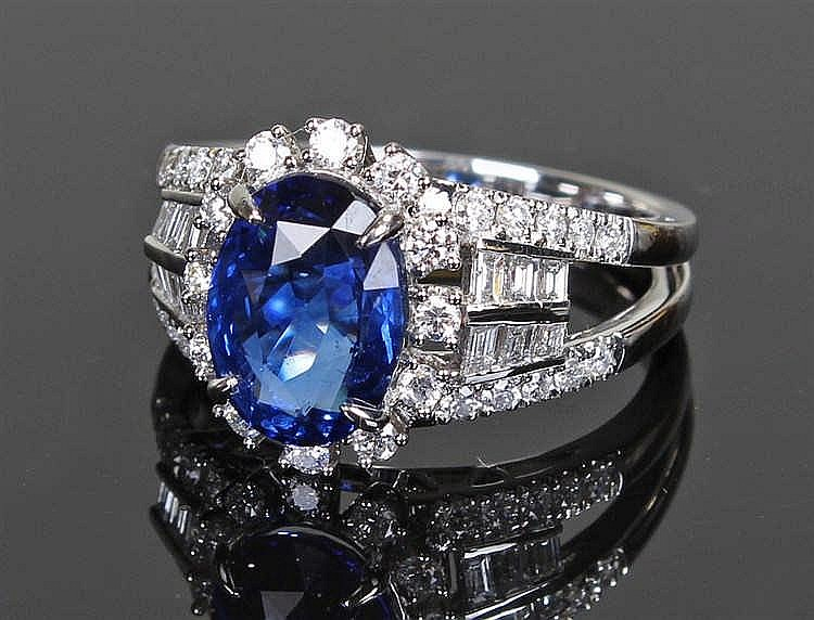 David Jerome Collection Sri Lankan and diamond ring, the central oval facet