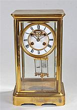 Early 20th Century brass, four glass, eight day mantel clock, the four beve
