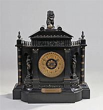 Victorian black slate mantel clock, surmounted by a bronze lion above a cla