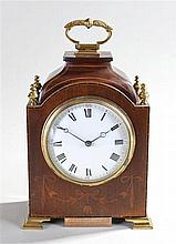 French inlaid mahogany clock, the gilt metal handle above a squat shaped pa