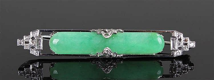 18 carat white gold diamond and jade brooch, the spinach jade bar flanked b