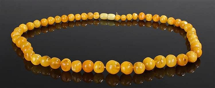 Composite yellow amber necklace, with a tapering row of yellow amber beads,