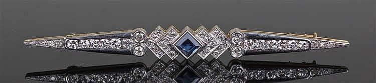 Diamond and sapphire brooch, the central sapphire flanked by diamonds mount