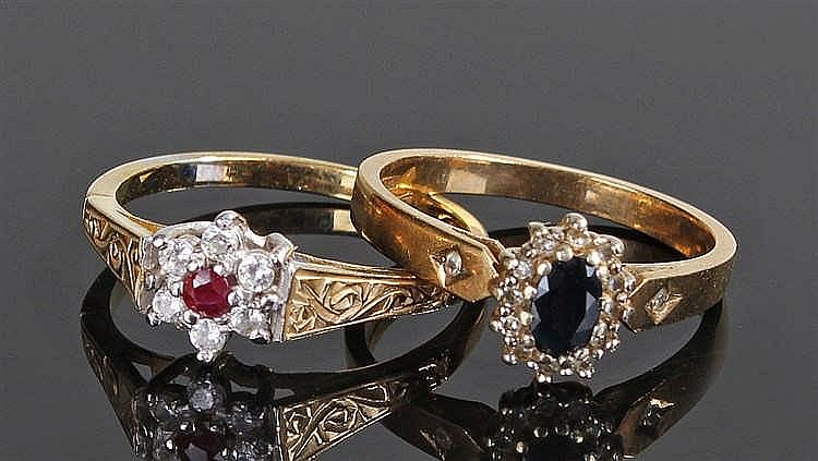 Two 9 carat gold rings, one set with a sapphire the other with a ruby, ring